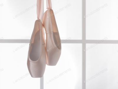 Pink ballet pointe shoes hanging on window photo by Prostock studio ...