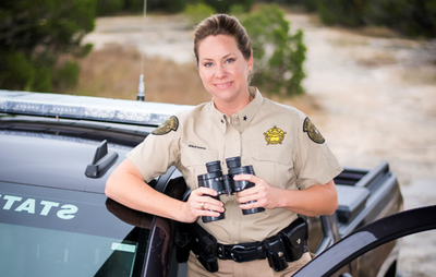Brandi Reeder by Game Warden Truck.PNG — Texas Parks & Wildlife ...