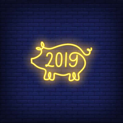 twenty nineteen neon sign with yellow pig shape night bright advertisement 2554260
